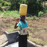 The Water Project: Mahira Community, Jairus Mwera Spring -  Carrying Clean Water Home