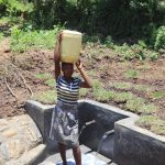The Water Project: Mahira Community, Jairus Mwera Spring -  Carrying Water From The Spring