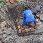 The Water Project: Mahira Community, Jairus Mwera Spring -  Brickwork