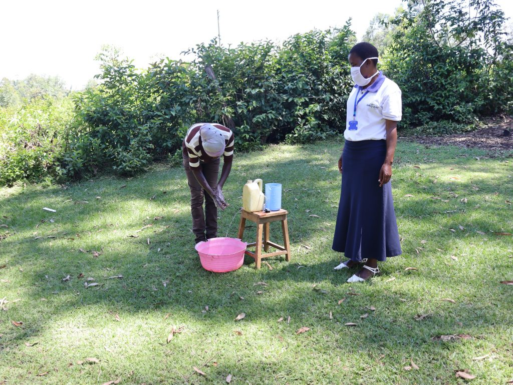 The Water Project : 8-covid19-kenya4574-using-a-built-handwashing-point
