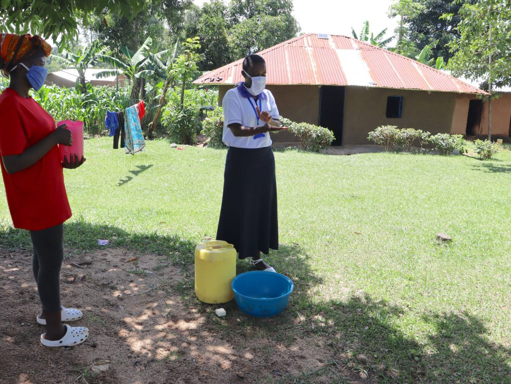 The Water Project : 9-covid19-kenya18087-when-washing-your-hands-ensure-you-clean-them-thoroughly