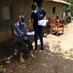 The Water Project: Masera Community, Ernest Mumbo Spring -  Facilitators Distributing Handouts To Facilitators