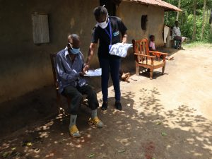 The Water Project:  Facilitators Distributing Handouts To Facilitators