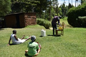 The Water Project:  Sir Erick Making A Leaky Tin