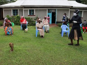 The Water Project:  Madam Shigali With Protective Gear Condicting Training