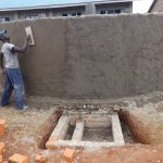 The Water Project: St. Teresa's Isanjiro Girls Secondary School -  Outside Tank Plaster