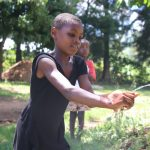The Water Project: Shibuli Community, Khamala Spring -  A Girl Demonstrating Her Handwashing Skills