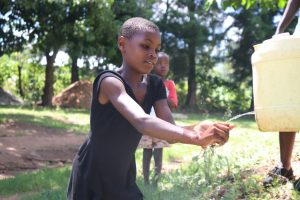 The Water Project:  A Girl Demonstrating Her Handwashing Skills