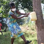 The Water Project: Shibuli Community, Khamala Spring -  Demonstrating How To Make A Leaky Tin