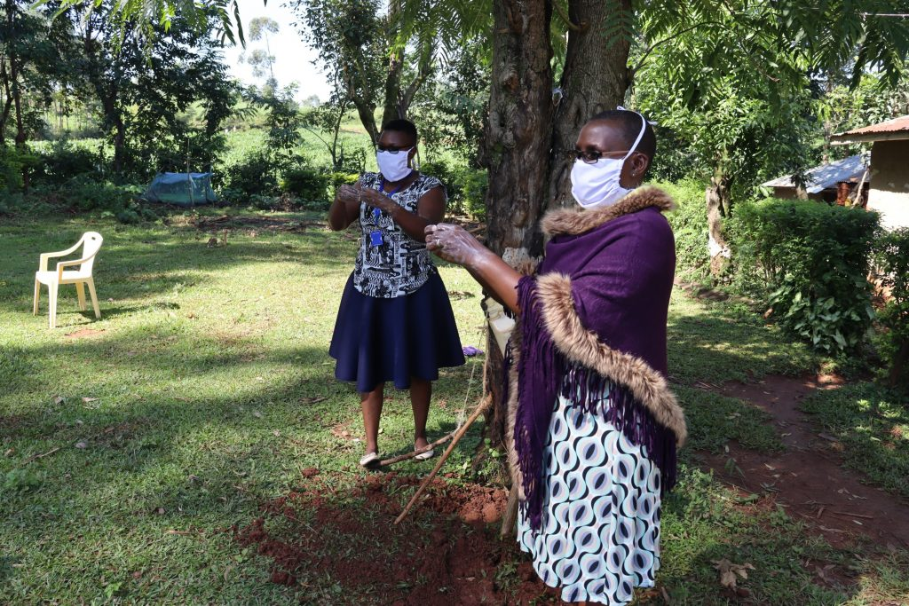 The Water Project : covid19-kenya18090-demonstrating-ten-handwashing-steps