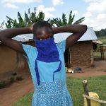 The Water Project: Musango Community, Ham Mwenje Spring -  Awinja Trys On A Mask She Sewed At The Training