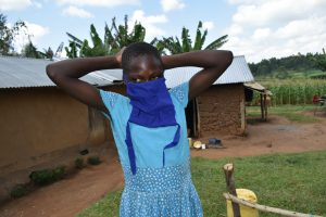 The Water Project:  Awinja Trys On A Mask She Sewed At The Training