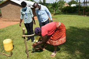 The Water Project:  Community Member Using A Simple Handwashing Station
