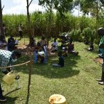 The Water Project: Musango Community, Ham Mwenje Spring -  Participants Eager To See How The Handwashing Station Works