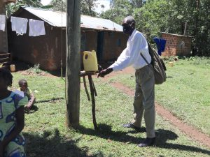 The Water Project:  An Elder Uses An Installed Leaky Tin In The Community