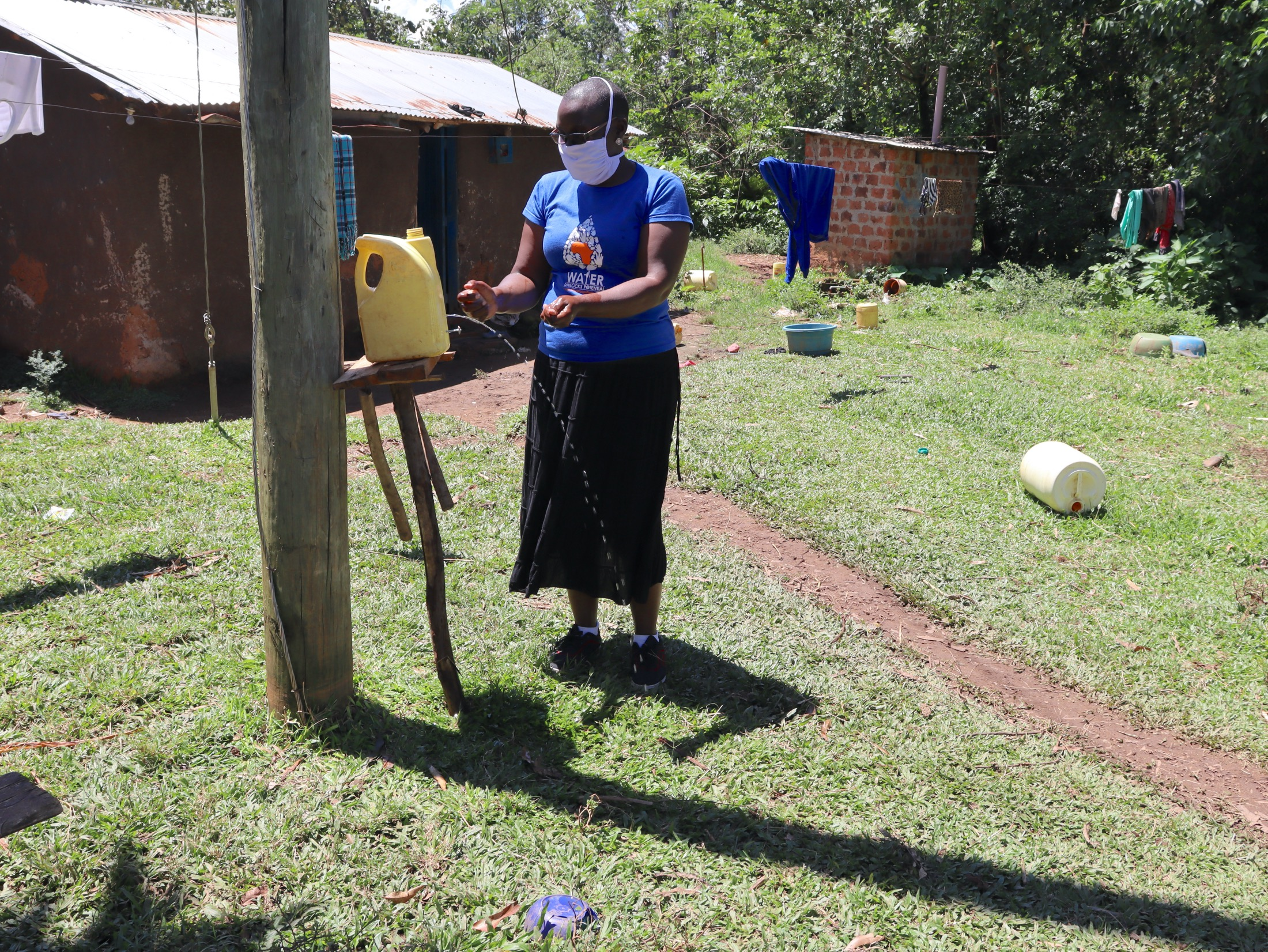 The Water Project : covid19-kenya18124-an-insatlled-handwashing-leaky-tin-in-the-community