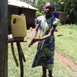 The Water Project: Muraka Community, Peter Itevete Spring -  Using A Homemadhandwashing Station