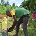 The Water Project: Mungaha B Community, Maria Spring -  A Gent Washing His Hands