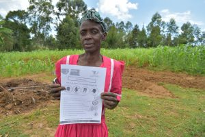 The Water Project:  Ms Maria Holding Up A Manual