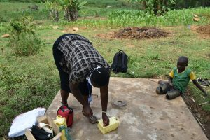 The Water Project:  The Faciliatator Making A Leaky Tin