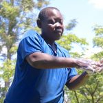 The Water Project: Isembe Community, Amwayi Spring -  A Community Member Demonstrating The Handwashing Process