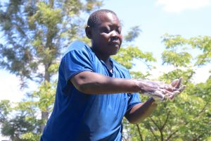 The Water Project:  A Community Member Demonstrating The Handwashing Process