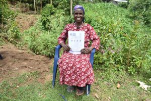 The Water Project:  A Community Member Smiling With Her Pamphlet