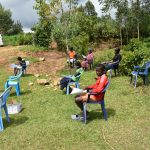 The Water Project: Emaka Community, Ateka Spring -  Community Members Settling In For The Training