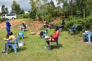The Water Project:  Community Members Settling In For The Training