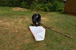The Water Project:  Mr Wagaka Mounting The Chart On The Support Poles