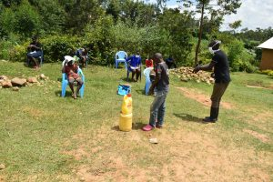 The Water Project:  The Facilitator Demonstrating The Handwashing Exercise