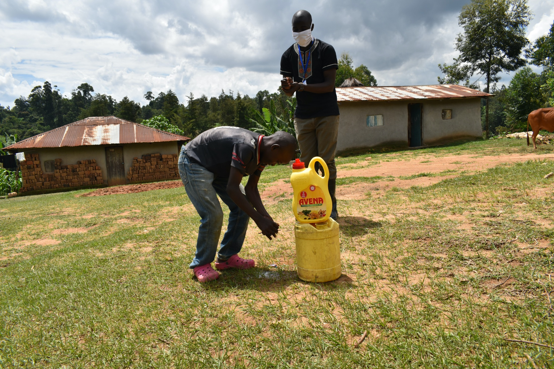 The Water Project : covid19-kenya18149-the-facilitator-leading-the-handwashing-exercise