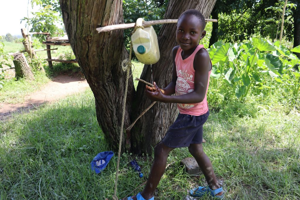 The Water Project : covid19-kenya18150-using-hands-free-handwashing-point
