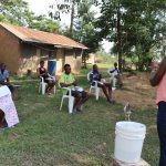 The Water Project: Ematetie Community, Chibusia Spring -  Ms Patricia Leading The Handwashing Exercise