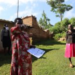 The Water Project: Koloch Community, Solomon Pendi Spring -  A Community Health Worker Illustrates Sneezing Into The Elbow