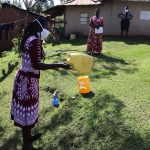 The Water Project: Koloch Community, Solomon Pendi Spring -  Making Handwashing Stations Using Local Materials
