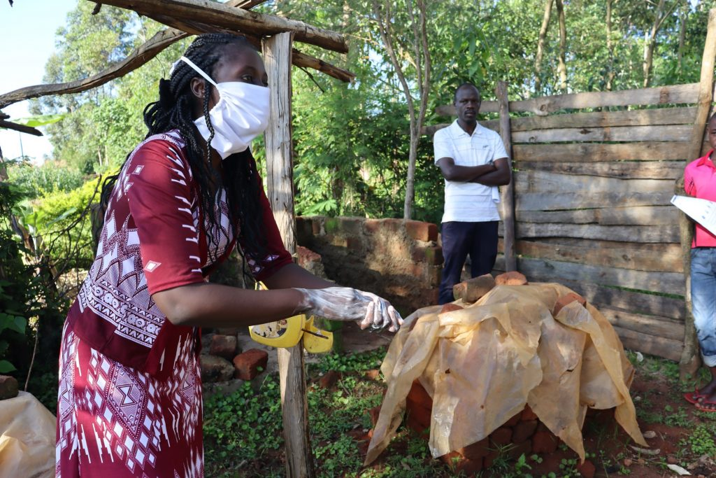 The Water Project : covid19-kenya18160-handwashing-with-soap-is-essential-in-breaking-down-the-virus