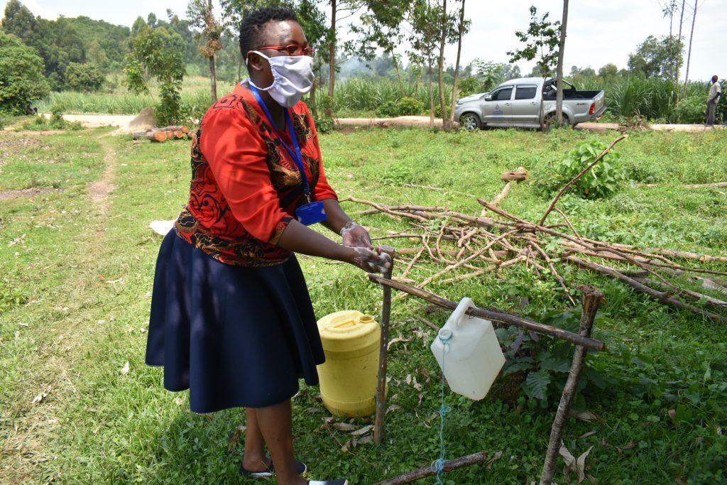 The Water Project : covid19-kenya18166-the-facilitator-demonstrating-the-handwashing-steps