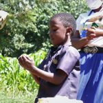 The Water Project: Bukhakunga Community, Khayati Spring -  A Kid Demonstrates Handwashing