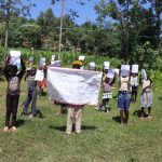 The Water Project: Bukhakunga Community, Khayati Spring -  Community Members Show Training Materials