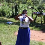 The Water Project: Bukhakunga Community, Khayati Spring -  Facilitator Shows Proper Way Of Wearing Masks