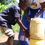 The Water Project: Bukhakunga Community, Khayati Spring -  Using An Improvised Handwashing Station In The Community