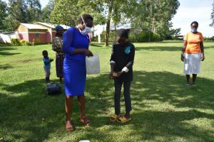 The Water Project:  A Boy Showing The Members How Handwashing Is Done