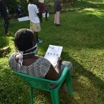 The Water Project: Mukoko Community, Mukoko Spring -  A Community Member Reading Through The Manual