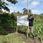The Water Project: Mukoko Community, Mukoko Spring -  Mr Wagaka Erecting The Poles At The Spring