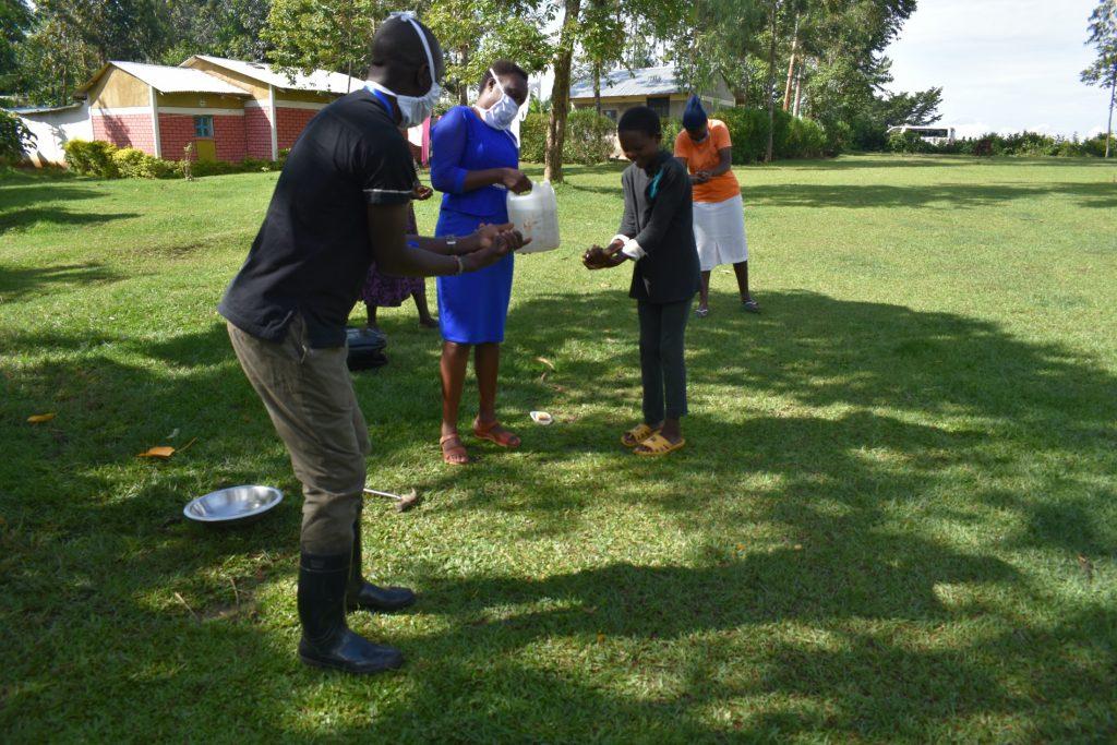 The Water Project : covid19-kenya19096-the-handwashing-exercise-at-mukoko-spring