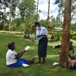The Water Project: Sichinji Community, Makhatse Spring -  Ms Serete Handing Out The Training Manuals