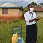 The Water Project: Sichinji Community, Makhatse Spring -  The Facilitator Demonstrating Handwashing