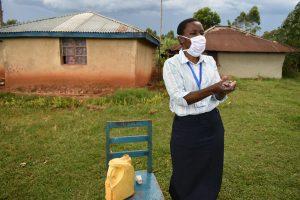 The Water Project:  The Facilitator Demonstrating Handwashing