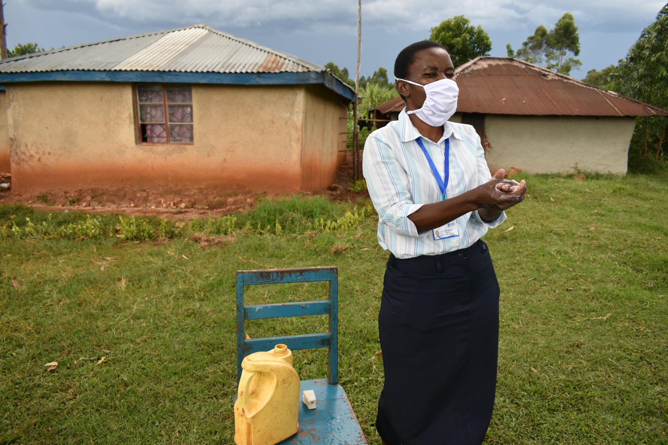 The Water Project : covid19-kenya19097-the-facilitator-demonstrating-handwashing